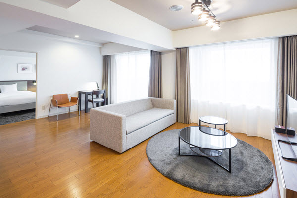 With more reasonable pricing thanks to its location just outside the city center, this residence offers more spacious accommodations.  This  two-bedroom serviced apartment is 90 sq.m ,  and can sleep